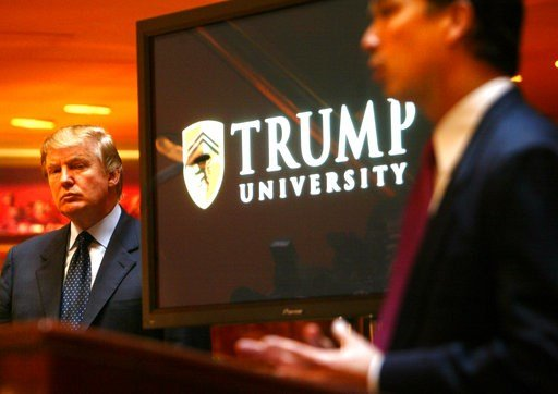 (AP Photo/Bebeto Matthews,File). In this Monday May 23, 2005 file photo Donald Trump, left, listens as Michael Sexton introduces him to announce the establishment of Trump University at a press conference in New York. A federal appeals court has upheld...