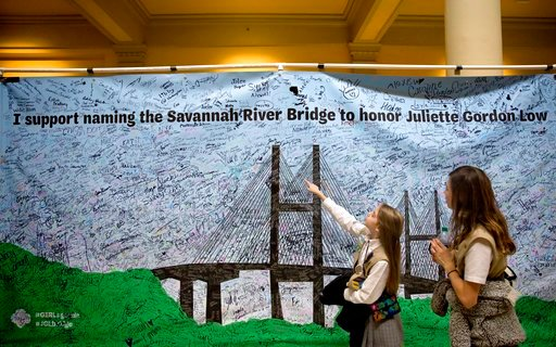(AP Photo/David Goldman). Girl Scouts Veronica Ward, 11, right, and Audra Duncan, 12, look at a signed banner on display at the Georgia Capitol during a rally to convince legislators to strip the name of segregationist former Gov. Eugene Talmadge from ...