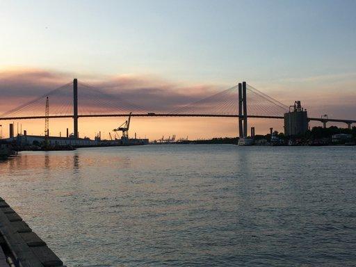 (AP Photo/Sally Hale, File). FILE - This April 20, 2017, file photo shows the Eugene Talmadge Memorial Bridge at sunset in Savannah, Ga. Hundreds of Girl Scouts are expected to gather in the Georgia Capitol, Tuesday, Feb. 6, 2018, offering milk and coo...