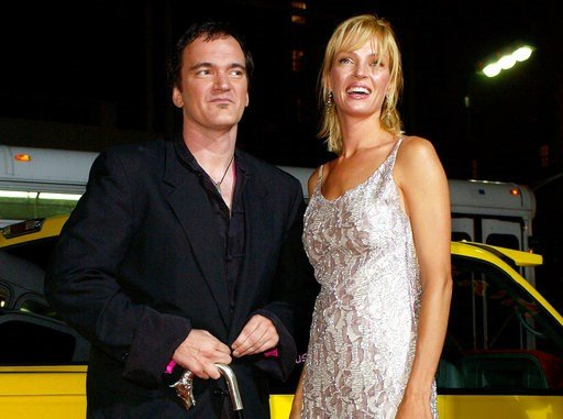 "(AP Photo/Kevork Djansezian, File). FILE - In this Sept. 29, 2003 file photo, director of the film ""Kill Bill: Volume 1,"" Quentin Tarantino, left, and actress Uma Thurman arrive at the premiere of the film in Los Angeles. Tarantino has expressed sorrow..."