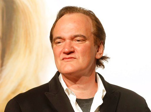 (AP Photo/Laurent Cipriani, File). FILE - This Oct. 8, 2016 file photo, director Quentin Tarantino appears at the opening ceremony of the 8th Lumiere Festival, in Lyon, central France. Tarantino has expressed sorrow for the car crash that injured Uma T...