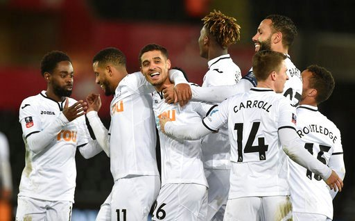 (Simon Galloway/PA via AP). Swansea City's Kyle Naughton (centre) celebrates with his team-mates after scoring his side's fifth goal against Notts County during the Emirates FA Cup, fourth round replay match at the Liberty Stadium in Swansea, England, ...