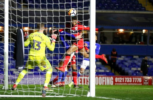 (Martin Rickett/PA via AP). Huddersfield Town's Steve Mounie, right, scores his side's second goal of the game during the English FA Cup, fourth round replay match Birmingham City versus Huddersfield Town at St Andrews, Birmingham, England Tuesday Feb....