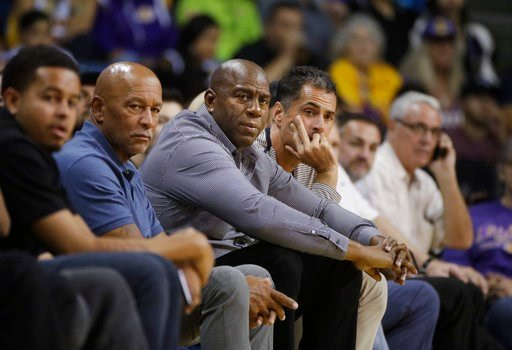 (AP Photo/Jae C. Hong). FILE - In this Oct. 4, 2017 file photo Los Angeles Lakers general manager Rob Pelinka, center right, and Magic Johnson watch the team's NBA preseason basketball game against the Denver Nuggets in Ontario, Calif. The Lakers have ...