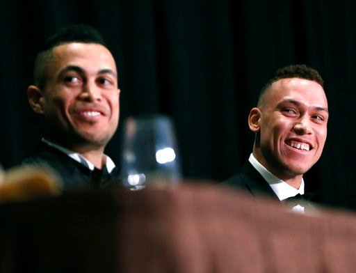 (AP Photo/Kathy Willens). This Jan. 28, 2018 photo shows National League Most Valuable Player Giancarlo Stanton, left, and American League Rookie of the Year Aaron Judge sitting side-by-side during the New York Chapter of the Baseball Writers' Associat...