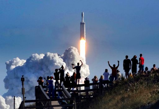 (Joe Burbank/Orlando Sentinel via AP). The crowd cheers at Playalinda Beach in the Canaveral National Seashore, just north of the Kennedy Space Center, during the successful launch of the SpaceX Falcon Heavy rocket, Tuesday, Feb. 6, 2018. Playalinda is...