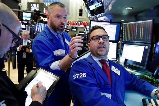 (AP Photo/Richard Drew). Trader Kevin Lodewick, center, and specialist Paul Cosentino, right, work on the floor of the New York Stock Exchange, Tuesday, Feb. 6, 2018. The Dow Jones industrial average fell as much as 500 points in early trading, bringin...