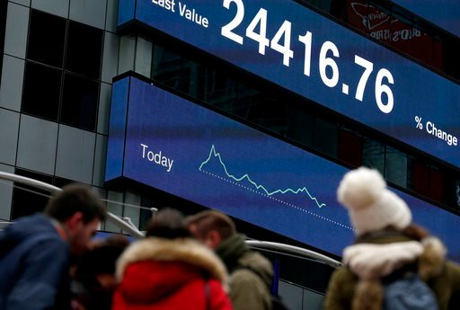(AP Photo/Seth Wenig). A display shows financial indices in Times Square, New York, Tuesday, Feb. 6, 2018. After big swings higher and lower, U.S. stocks are up slightly in afternoon trading Tuesday as investors look for calm after a global sell-off. T...