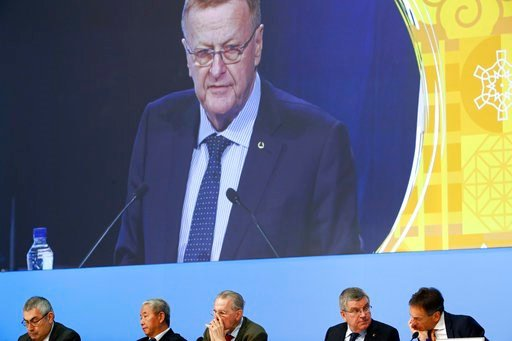 (AP Photo/Patrick Semansky). International Olympic Committee member and Court of Arbitration for Sport president John Coates is projected on a screen as he delivers a report on the Tokyo 2020 Summer Olympics during the 132nd IOC Session prior to the 20...