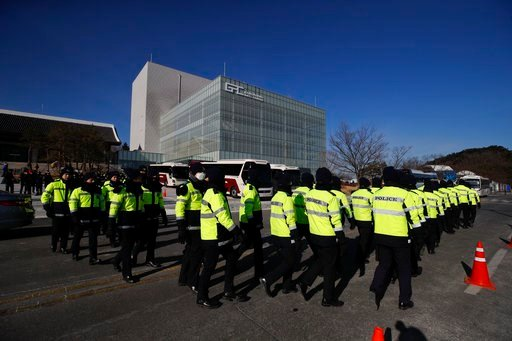 (AP Photo/Jae C. Hong). Police officers surround the Gangneung Art Center while members of North Korea's Samjiyon art troupe tour the facility prior to the 2018 Winter Olympics in Gangneung, South Korea, Wednesday, Feb. 7, 2018.
