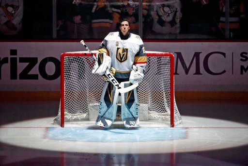 (AP Photo/Gene J. Puskar). Vegas Golden Knights goaltender Marc-Andre Fleury stands during the national anthem before the team's NHL hockey game against his former team, the Pittsburgh Penguins, in Pittsburgh on Tuesday, Feb. 6, 2018. It was Fleury's f...