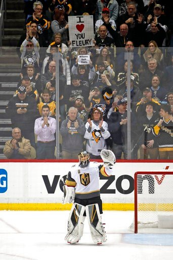 (AP Photo/Gene J. Puskar). Vegas Golden Knights goaltender Marc-Andre Fleury waves to the crowd after a video tribute to his three Stanley Cups with the Pittsburgh Penguins, during the first period of an NHL hockey game in Pittsburgh, Tuesday, Feb. 6, ...