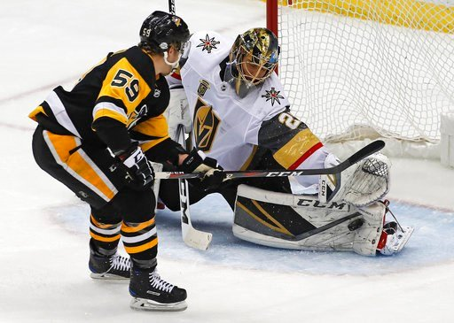 (AP Photo/Gene J. Puskar). Vegas Golden Knights goaltender Marc-Andre Fleury (29) stop a shot by Pittsburgh Penguins' Jake Guentzel (59) during the first period of an NHL hockey game in Pittsburgh, Tuesday, Feb. 6, 2018.