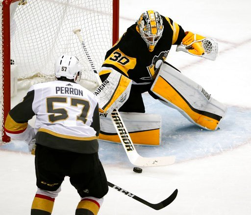 (AP Photo/Gene J. Puskar). Pittsburgh Penguins goaltender Matt Murray (30) stops a shot by Vegas Golden Knights' David Perron (57) during the first period of an NHL hockey game in Pittsburgh, Tuesday, Feb. 6, 2018.