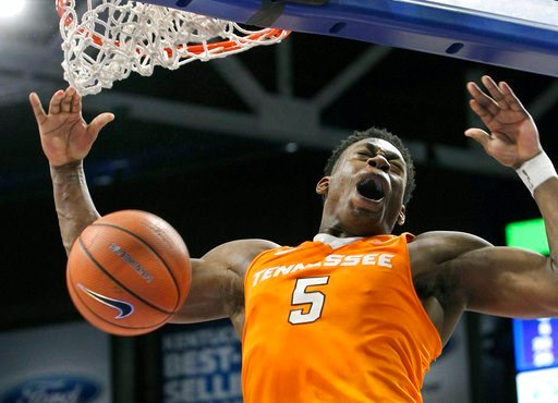 (AP Photo/James Crisp). Tennessee's Admiral Schofield dunks for Tennessee's final basket in their 61-59 win over Kentucky during an NCAA college basketball game, Tuesday, Feb. 6, 2018, in Lexington, Ky.
