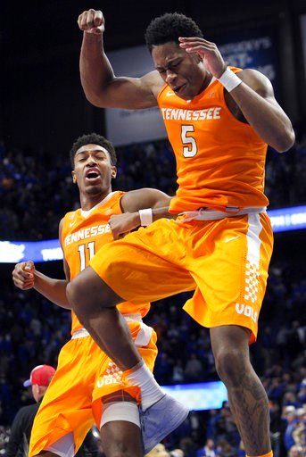 (AP Photo/James Crisp). Tennessee's Admiral Schofield (5) and Kyle Alexander (11) celebrate after an NCAA college basketball game against Kentucky, Tuesday, Feb. 6, 2018, in Lexington, Ky. Tennessee won 61-59.