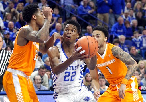 (AP Photo/James Crisp). Kentucky's Shai Gilgeous-Alexander, middle, drives between Tennessee's Jordan Bowden, left, and Lamonte Turner (1) during the first half of an NCAA college basketball game, Tuesday, Feb. 6, 2018, in Lexington, Ky.