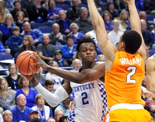 (AP Photo/James Crisp). Kentucky's Jarred Vanderbilt, left, looks for an opening on Tennessee's Grant Williams during the first half of an NCAA college basketball game, Tuesday, Feb. 6, 2018, in Lexington, Ky.