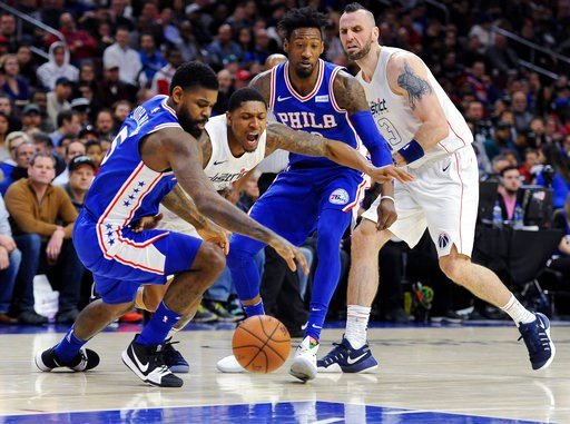 (AP Photo/Michael Perez). Washington Wizards' Bradley Beal (3) and Philadelphia 76ers' Amir Johnson (5) chase down a loose ball in the first half of an NBA basketball game, Tuesday, Feb 6, 2018, in Philadelphia.