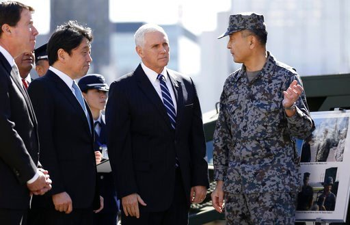 (Toru Hanai/Pool Photo via AP). U.S. Vice President Mike Pence, second from right, speaks with an officer of the Japan's Ground Self-Defense Force as he inspects a PAC-3 interceptor missile system with Japanese Defense Minister Itsunori Onodera, second...