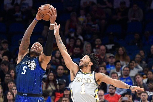 (AP Photo/Phelan M. Ebenhack). Orlando Magic forward Marreese Speights (5) grabs a pass in front of Cleveland Cavaliers guard Derrick Rose (1) during the first half of NBA basketball game Tuesday, Feb. 6, 2018, in Orlando, Fla.