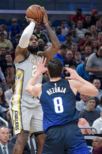 (AP Photo/Phelan M. Ebenhack). Cleveland Cavaliers forward LeBron James (23) goes up for a shot in front of Orlando Magic guard Mario Hezonja (8) during the first half of NBA basketball game Tuesday, Feb. 6, 2018, in Orlando, Fla.