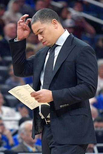 (AP Photo/Phelan M. Ebenhack). Cleveland Cavaliers head coach Tyronn Lue checks his notes during a timeout in the first half of NBA basketball game against the Orlando Magic Tuesday, Feb. 6, 2018, in Orlando, Fla.