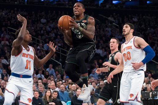 (AP Photo/Mary Altaffer). Milwaukee Bucks guard Eric Bledsoe (6) goes to the basket past New York Knicks guard Frank Ntilikina (11) and center Enes Kanter (00) during the first half of an NBA basketball game Tuesday, Feb. 6, 2018, at Madison Square Gar...