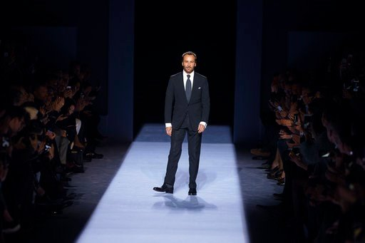 (AP Photo/Andres Kudacki). Designer Tom Ford salutes during his men's collection show at the Men's Fashion Week in New York, Tuesday, Feb. 6, 2018.
