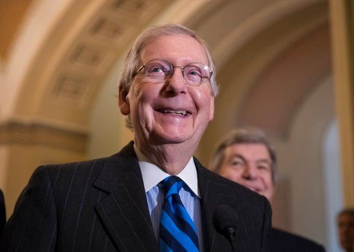 (AP Photo/J. Scott Applewhite). Senate Majority Leader Mitch McConnell, R-Ky., smiles as he meets with reporters as work continues on a plan to keep the government as a funding deadline approaches, at the Capitol in Washington, Tuesday, Feb. 6, 2018.