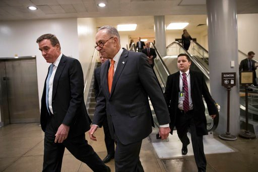 (AP Photo/J. Scott Applewhite). Senate Minority Leader Chuck Schumer, D-N.Y., center, and Sen. Mark Warner, D-Va., left, the vice chair of the Senate Select Committee on Intelligence, head to a closed security briefing at the Capitol in Washington, Tue...
