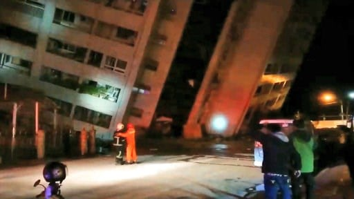 (EBC via AP). In this image from TV, emergency services attend after a building collapsed onto it's side, following an earthquake in Hualien County, eastern Taiwan, early Wednesday, Feb. 7, 2018.  A magnitude-6.4 earthquake struck late Tuesday near the...