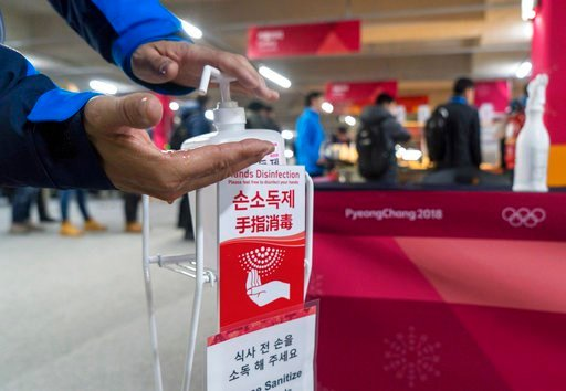 (Paul Chiasson/The Canadian Press via AP). A man sanitizes his hands at the entrance to the media cafeteria in Gangneung, South Korea, Wednesday, Feb. 7, 2018. South Korean authorities deployed 900 military personnel at the Pyeongchang Olympics on Tues...