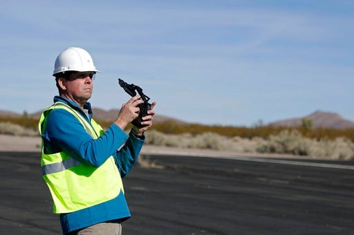 (AP Photo/Isaac Brekken). Keven Gambold, CEO of Unmanned Experts, demonstrates how to fly a drone at the Searchlight airport in Searchlight, Nev., on Wednesday, Jan. 17, 2018. Gambold, a hacking target, said the Russians might be counting on espionage ...