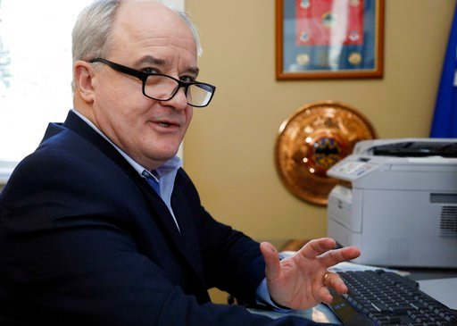 (AP Photo/Rogelio V. Solis). Retired Air Force Maj. Gen. James Poss, speaks in his home office in Ocean Springs, Miss., on Jan. 17, 2018. Poss, whose Gmail was nearly compromised in a phishing attempt, said that military spying is now far easier than w...