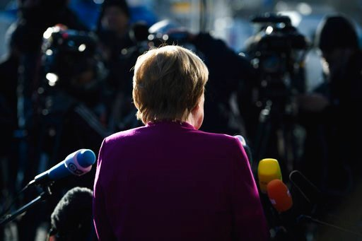 (Gregor Fischer/dpa via AP). German Chancellor Angela Merkel gives a brief statement when arriving for what is supposed the last day of the coalition talks between her Christian Democratic bloc and the Social Democratic party at the CDU headquarters in...