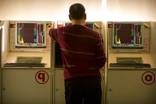 "(AP Photo/Mark Schiefelbein). A Chinese investor uses a computer terminal to monitor stock prices at a brokerage house in Beijing, Wednesday, Feb. 7, 2018. Asian shares recouped losses across the board on Wednesday, mirroring the ""correction"" rally on ..."