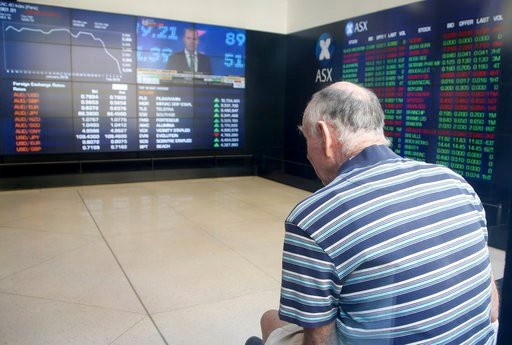 (AP Photo/Rick Rycroft). A man watches display boards at the Australian Stock Exchange in Sydney, Wednesday, Feb. 7, 2018. Major indexes in Asia and Europe Tuesday took steep losses and U.S. markets started sharply lower, only to repeatedly change dire...