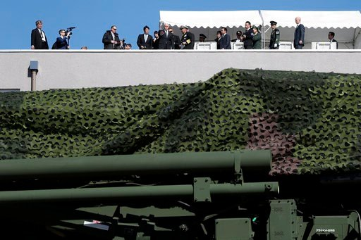 (Kiyoshi Ota/Pool Photo via AP). U.S. Vice President Mike Pence, top center, inspects a PAC-3 interceptor missile system with Japanese Defense Minister Itsunori Onodera, top center left, at Defense Ministry in Tokyo Wednesday, Feb. 7, 2018. Pence, who ...