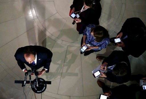 (AP Photo/Alex Brandon). Rep. Adam Schiff, D-Calif., ranking member of the House Committee on Intelligence, speaks during a media availability as reporters keep an eye on their phones, after a closed-door meeting of the House Intelligence Committee on ...