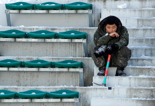 (AP Photo/Charlie Riedel). A soldier takes a break from shoveling snow and ice from the seating area at the Alpensia Ski Jumping Center ahead of the 2018 Winter Olympics in Pyeongchang, South Korea, Wednesday, Feb. 7, 2018.