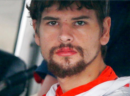 (AP Photo/Michael Dwyer, File). FILE - In this Sept. 27, 2016, file photo, Nathan Carman arrives in a small boat at the US Coast Guard station in Boston after spending a week at sea in a life raft before being rescued by a passing freighter. Carman, wh...
