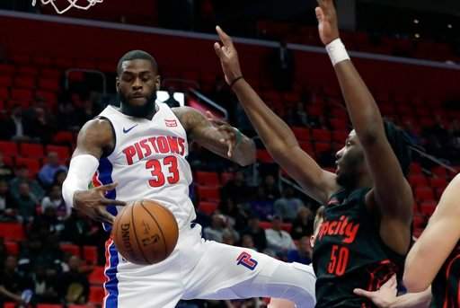 (AP Photo/Carlos Osorio). Detroit Pistons center Willie Reed (33) grabs a rebound as Portland Trail Blazers forward Caleb Swanigan (50) defends during the second half of an NBA basketball game, Monday, Feb. 5, 2018, in Detroit.