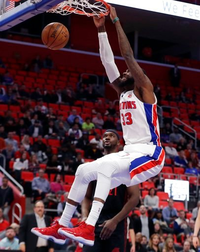 (AP Photo/Carlos Osorio). Detroit Pistons center Willie Reed dunks during the second half of an NBA basketball game against the Portland Trail Blazers, Monday, Feb. 5, 2018, in Detroit.