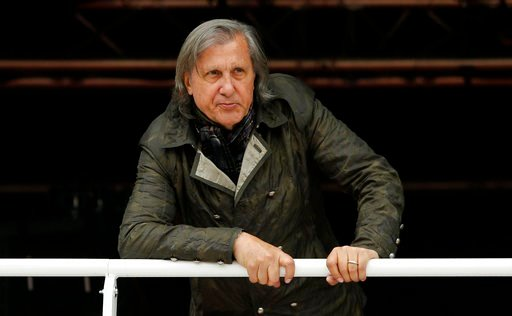 (AP Photo/Alastair Grant, File). FILE - In this Monday, May 23, 2016 file picture, former Romanian tennis ace Ilie Nastase watches a match of the French Open tennis tournament at the Roland Garros stadium, in Paris, France. On Wednesday Feb. 7, 2018  I...
