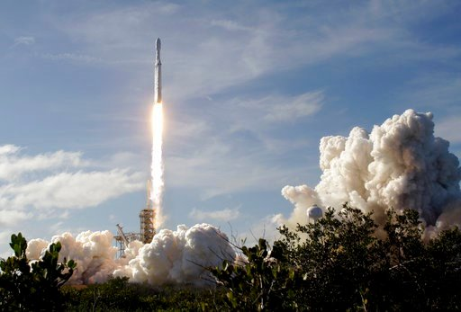 (AP Photo/Terry Renna). A Falcon 9 SpaceX heavy rocket lifts off from pad 39A at the Kennedy Space Center in Cape Canaveral, Fla., Tuesday, Feb. 6, 2018. The Falcon Heavy, has three first-stage boosters, strapped together with 27 engines in all.