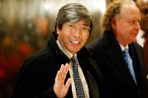 (AP Photo/Evan Vucci, File). FILE - In this Jan. 10, 2017, file photo, pharmaceuticals billionaire Dr. Patrick Soon-Shiong waves as he arrives in the lobby of Trump Tower in New York for a meeting with President-elect Donald Trump. The Los Angeles Time...