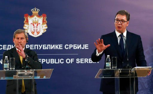 (AP Photo/Darko Vojinovic). Serbia's President Aleksandar Vucic, right, speaks during a press conference after talks with EU Enlargement Commissioner Johannes Hahn, left, in Belgrade, Serbia, Wednesday, Feb. 7, 2018. Hahn says Serbia must reach an agre...