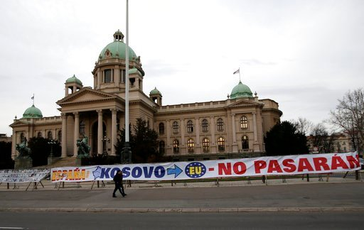 (AP Photo/Darko Vojinovic). A banner outside the Serbian parliament building praises Spanish refusal to recognise the former Serbian province of Kosovo which declared independence a decade ago in Belgrade, Serbia, Wednesday, Feb. 7, 2018. European Unio...