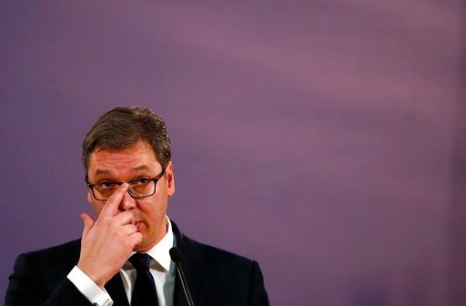 (AP Photo/Darko Vojinovic). Serbia's President Aleksandar Vucic listens to a question during a press conference after talks with EU Enlargement Commissioner Johannes Hahn, left, in Belgrade, Serbia, Wednesday, Feb. 7, 2018. Hahn says Serbia must reach ...